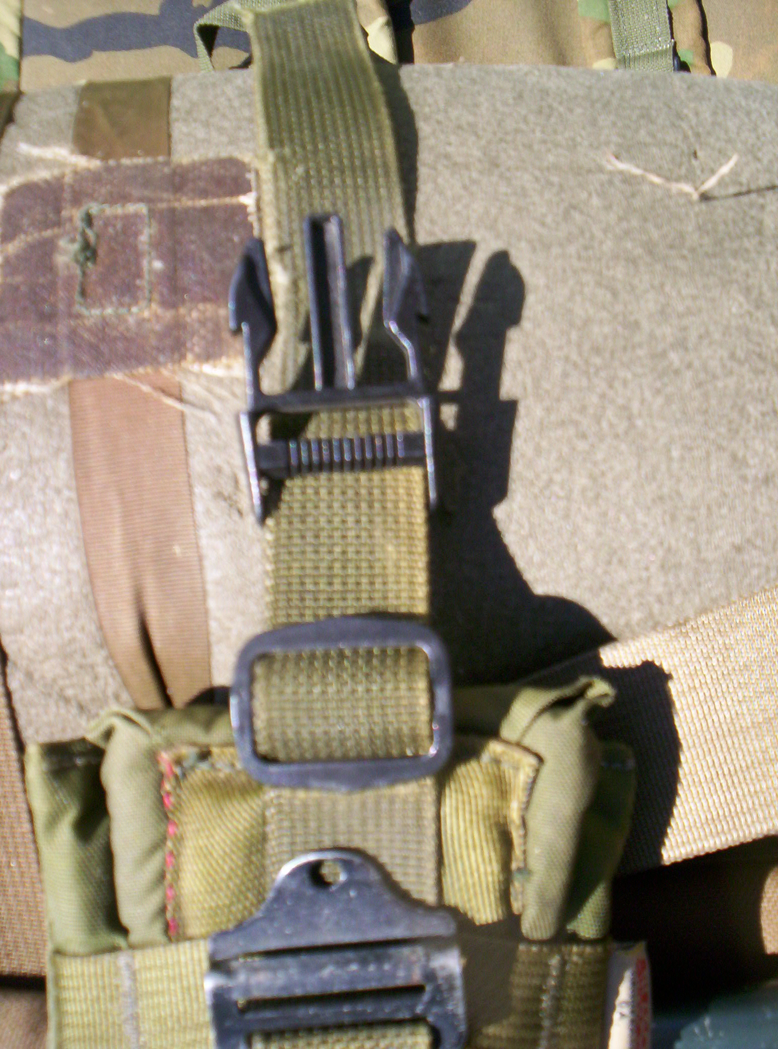 run the tip of the strap under the frame through the slot made for the shoulder strap and back around