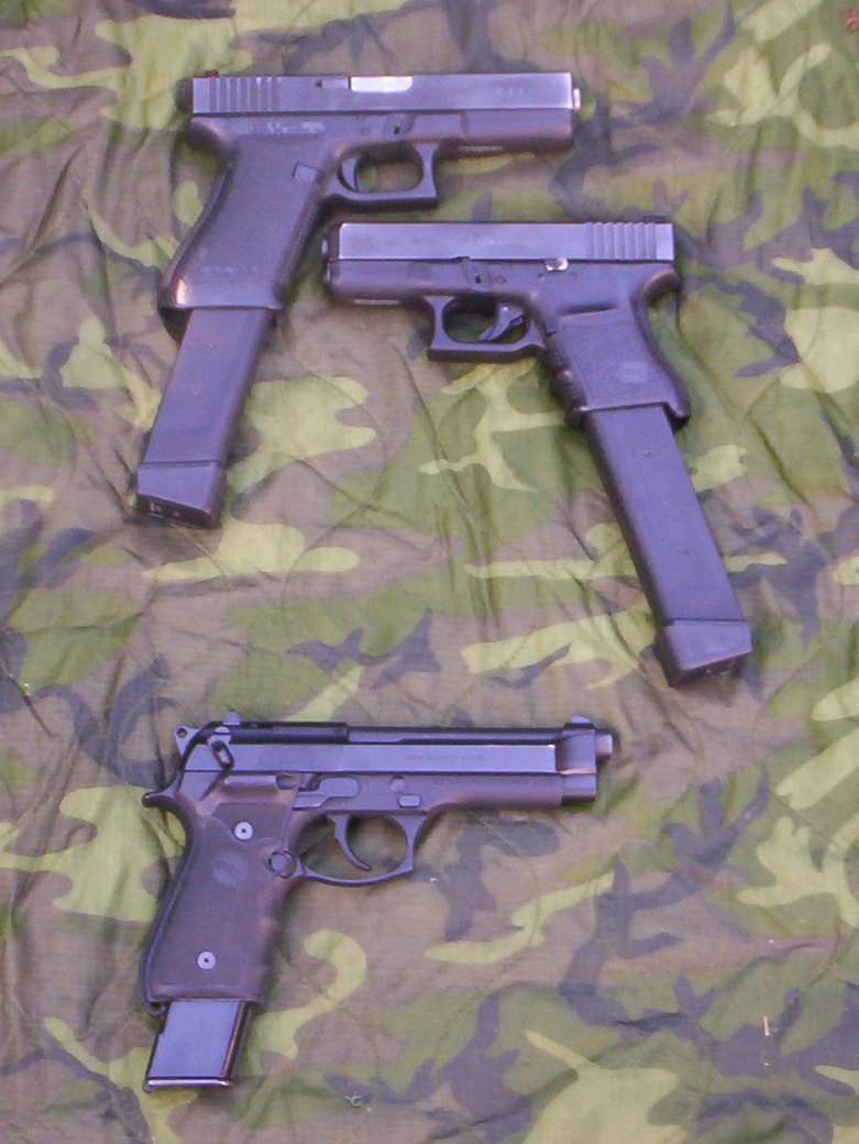 Top is the full size Glock 21 with the extended 27 round magazine, below is the Glock 30 with the same mag. Bottom is a Beretta M9 with the 20 round factory mag made for the M93R.