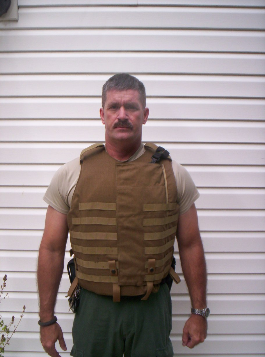 Interceptor Body Armor with a pancake holstered M9.