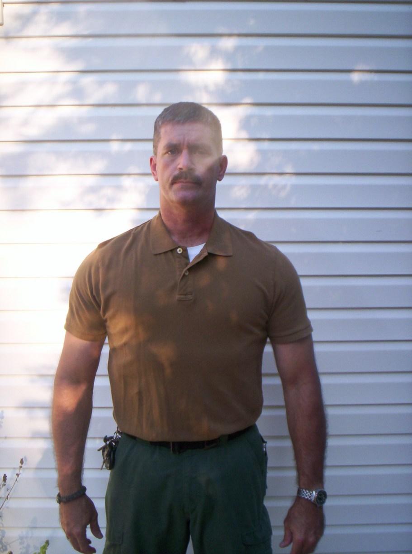 PF9 in Tru Spec holster shirt under a polo shirt